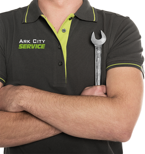 Close up of HVAC technician holding a wrench.